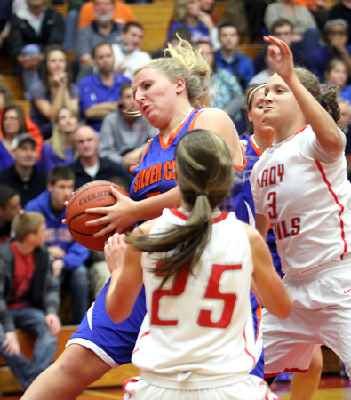 Silver Creek senior Kristi Molck pulls down a rebound against Jeffersonville on Friday night. Staff photo by C.E. Branham