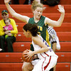 Floyd Central center Brianna Roth guards Bedford North Lawrence forward Dominique McBryde during the championship game of the New Albany sectional tournament on Saturday. Bedford North Lawrence won the game, 54-34. Staff photo by Christopher Fryer