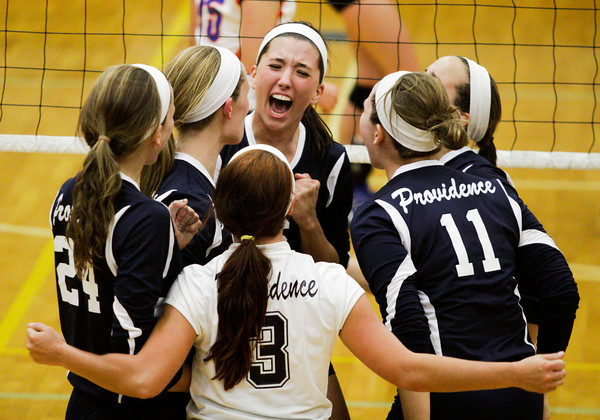 Providence celebrates after scoring a point against Silver Creek High School during their match at Providence on Wednesday evening. Providence won the match in the first three sets. Staff photo by Christopher Fryer