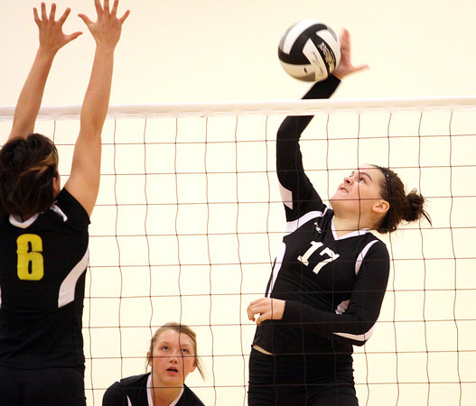 Henryville freshman Hannah White attempts kill against Clarksville in the opening match of the 2A Sectional Thursday night. Staff photo by C.E. Branham