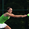 Floyd Central junior Olivia Boesing competing at No. 1 singles in the regional final. Staff photo by C.E. Branham