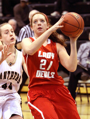 Jeffersonville junior Haley Vogen scores against Corydon Central on Thursday night. Staff photo by C.E. Branham