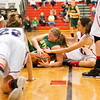 Floyd Central guard Brooke Hinton scrambles for a loose ball during their championship game against Bedford North Lawrence in the New Albany sectional tournament on Saturday. Bedford North Lawrence won the game, 54-34. Staff photo by Christopher Fryer