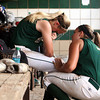 Floyd Central junior Briana Mayfield, right, talks to pitcher Morgan Harper after the Lady Highlanders gave up five runs in the seventh inning in a 11-4 loss to Castle in the 4A Regional. Staff photo by C.E. Branham