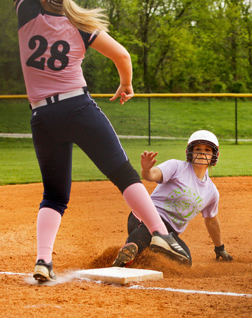 New Albany's Whitney Atkins slides safely into third base during their game against Providence on Tuesday. New Albany won the game, 3-0. Staff photo by Christopher Fryer
