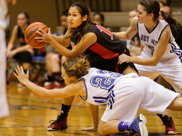 New Albany guard Stephanie Iglesias guards the ball from North Harrison guard Kendra Lambert, right, and forward Shaylah Neal during the first half of their game at North Harrison on Thursday. Staff photo by Christopher Fryer