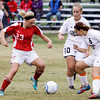 Jeffersonville sophomore Cortney Polk attempts to out maneuver Corydon Central junior Olivia Lawson, right, and senior Koko Sams during their game in the Indiana High School Athletic Association Girls Soccer Sectional at Floyd Central on Tuesday. Jeffersonville lost the game, 4-2. Staff photo by Christopher Fryer
