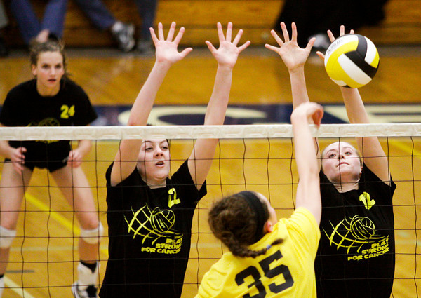 Providence junior Maile Daniel, left, and freshman Jacquie Hornung attempt to block a shot by Floyd Central freshman Gwyn Jones during their match at Providence on Tuesday. Floyd Central won the match in five sets. Staff photo by Christopher Fryer