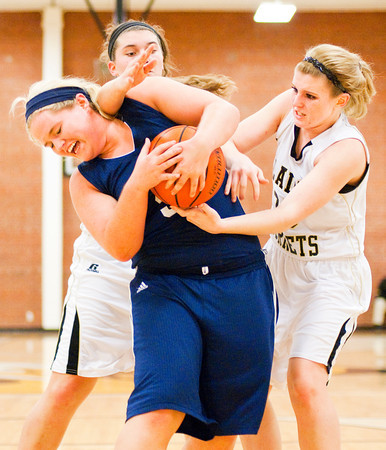 Providence center Lillian Hughes fights for a rebound during the Pioneers' 63-37 victory over Henryville in the championship game of the Henryville Tipoff Tournament on Saturday. Staff photo by Christopher Fryer