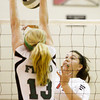 New Albany's Nicole Jones attempts to hit the ball past Floyd Central's Remi Bowman during the first game of their match at Floyd Central on Thursday. Staff photo by Christopher Fryer