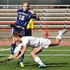 Providence defender Rachel Wells attempts to clear a corner kick during the second half of their Class A state championship match against Mishawaka Marian in Indianapolis on Saturday. Mishawaka Marian won the game, 2-0. Staff photo by Christopher Fryer
