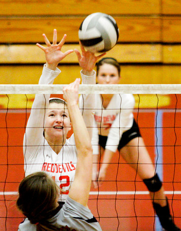 Jeffersonville senior Sam Grider rises up while attempting to block a shot during their home game against Southwestern on Wednesday. Staff photo by Christopher Fryer