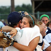 Providence shortstop Jordyn Stengel hugs her father and assistant coach Chad Stengel after the Lady Pioneers' 2A Sectional championship Thursday evening. Staff photo by C.E. Branham