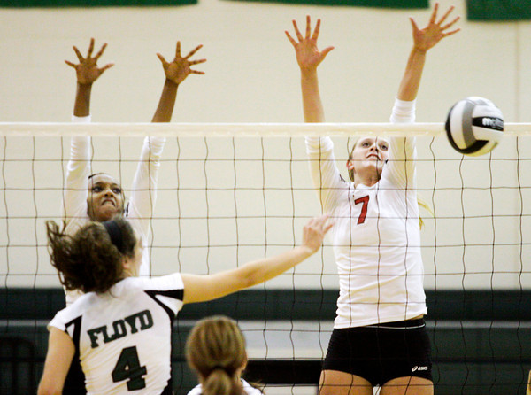 New Albany's Kelsey Guess, left, and Catlin Lily block a shot by Floyd Central's Sydney Engle during the third game of their match at Floyd Central on Thursday. Staff photo by Christopher Fryer