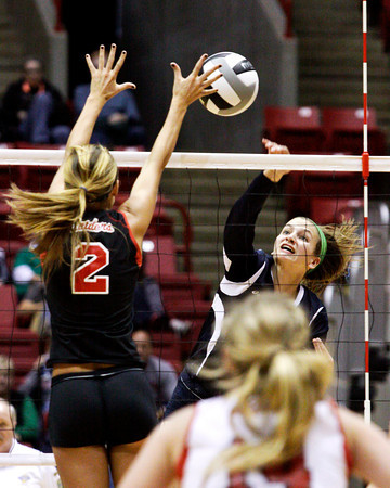 Providence sophomore Haley Libs attempts to hit a shot past Wapahani senior Brittany Cline during their Class 2A state championship match at Worthen Arena in Muncie on Saturday. Wapahani won the match in 4 sets. Staff photo by Christopher Fryer