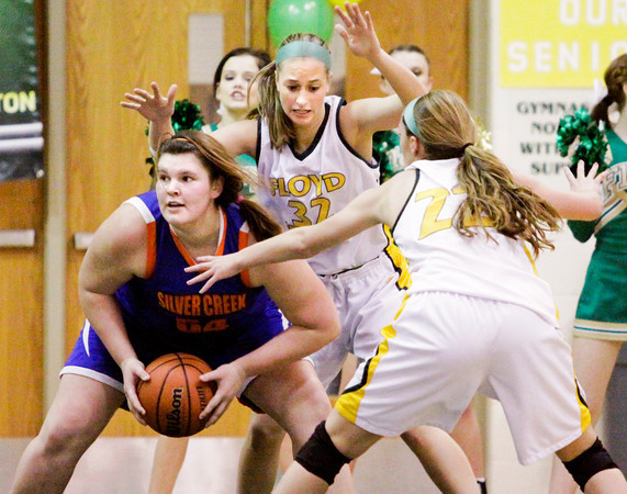 Silver Creek junior Kelsi Scott looks to pass out of pressure during the Dragons' game at Floyd Central on Thursday. Staff photo by Christopher Fryer