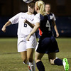 Providence forward Sarah Posante is challenged by Heritage Hills defender Rebecca Mercker as she attempts to control the ball during the second half of their regional championship game at Providence on Saturday. Providence won the game, 7-1. Staff photo by Christopher Fryer