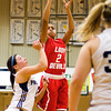 Jeffersonville guard Taylor Sykes goes up for a shot during their game at Providence on Thursday. Jeffersonville won the game, 35-19. Staff photo by Christopher Fryer