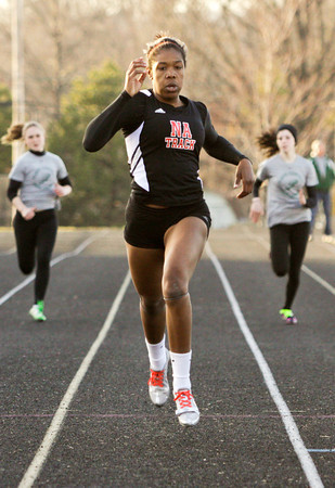 New Albany junior Jayla Bethel competes in the 200-meter dash during their home meet against Floyd Central on Tuesday. Staff photo by Christopher Fryer