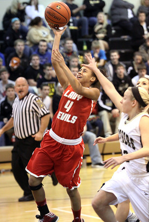 Jeff guard Chelsea Lewis scores off a steal Thursday night at Corydon Central. Staff photo by C.E. Branham