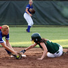 Floyd Central senior Kallie Krammes beats the tag of Castle shortstop Kayla Katterhenry while stealing second base in the 4A Regional. Staff photo by C.E. Branham