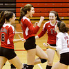 New Albany celebrates after scoring a point in the final set of their match against Evansville Central in the championship round of the River City Invitational at New Albany on Saturday. New Albany won the match in two sets, 25-21, 25-18. Staff photo by Christopher Fryer