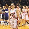 Borden senior Erin Mikel, who led the Lady Braves in scoring with 15 points, leads the team off the floor after a 35-31 loss to Northeast Dubois in the 1A regional final at West Washington.  Staff photo by C.E. Branham