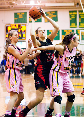 New Albany forward Claire Hirsch goes up for a shot during the Bulldogs' game at Floyd Central on Saturday. New Albany won the game, 54-46. Staff photo by Christopher Fryer