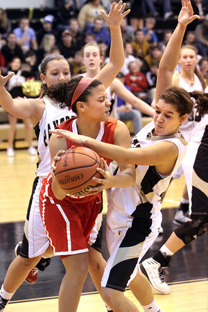 Jeffersonville junior Mackenzi Johnson looks to pass out of a Corydon Central trap Thursday night at Corydon. Staff photo by C.E. Branham