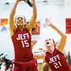 Jeffersonville forward Hailey Lacy comes down with a rebound during the Red Devils' game at New Albany on Friday. Staff photo by Christopher Fryer