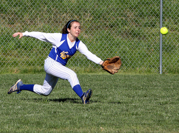 New Washington right fielder Whitney Leezer runs in on a hit by Henryville. Staff photo by C.E. Branham