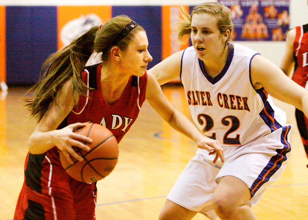 Borden's Leslie Beatty drives past Silver Creek's Alex Tinsley during their game at Silver Creek on Thursday. Staff photo by Christopher Fryer