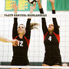 New Albany seniors Olivia Balmer, left, and Kelsey Guess attempt to block a shot during their match against Bedford North Lawrence in the Floyd Central Sectional on Thursday. Staff photo by Christopher Fryer