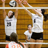 Providence juniors Patricia Mattingly, left, and Taylor Wilson attempt to block a shot during their match against Columbus East at the annual Providence Early Bird Invitational on Saturday. Columbus East won the match in three sets. Staff photo by Christopher Fryer