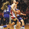 Borden senior Allison Rademacher takes the ball to the hoop for a basket against Northeast Dubois Saturday night in the 1A regional final at West Washington.  Staff photo by C.E. Branham