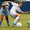 Providence High School sophomore Sarah Posante struggles for possession of the ball with Mercy Academy sophomore Sierra Hoagland during the first half of their match at Providence on Thursday evening. Staff photo by Christopher Fryer