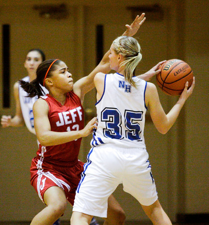 Jeffersonville sophomore Taylor Sykes guards North Harrison freshman Stevi Burns during their game at North Harrison on Friday. Staff photo by Christopher Fryer