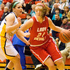 Jeffersonville's Haley Vogen drives to the basket during their game against Floyd Central in the New Albany sectional tournament on Tuesday. Floyd Central won the game 62-48. Staff photo by Christopher Fryer