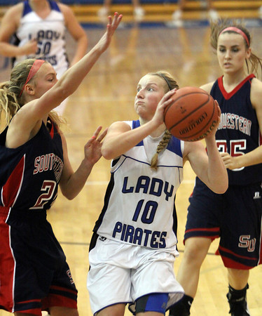 Charlestown guard Kaitlynn Henning puts up a shot against a Southwestern defender Thursday night at Charlestown. Staff photo by C.E. Branham