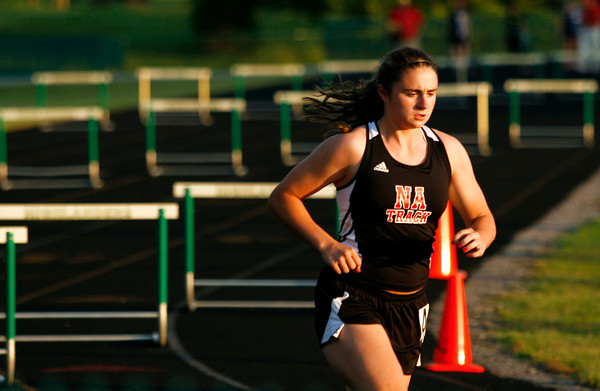 New Albany junior Kaelin Blessinger competes in the 300 meter hurdles during the Indiana High School Athletic Association Girls Track Sectional at Floyd Central High School on Tuesday evening. Staff photo by Christopher Fryer