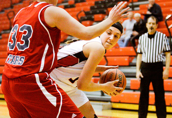 New Albany forward Claire Hirsch drives to the basket during the Bulldogs' home game against Bedford North Lawrence on Tuesday. Staff photo by Christopher Fryer