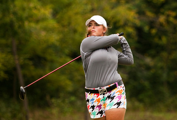 New Albany's Heidi Steinert tees off on the fifth hole during the sectional tournament at Old Capital Golf Club in Corydon on Thursday. Staff photo by Christopher Fryer