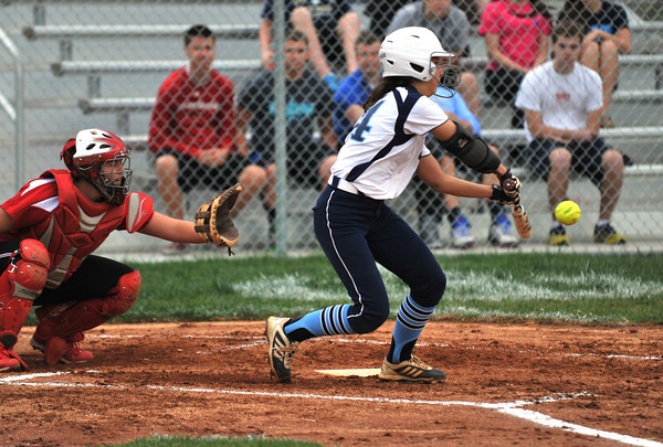 Pioneer senior Jordyn Stengel slaps the ball down toward the third base line for a single during Providences' game against New Albany on Tuesday. New Albany took the 7-6 lead in the top of the seventh inning, but the game was suspended due to rain.<br /> Staff photo by Tyler Stewart