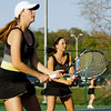 Floyd Central senior Whitney Batliner, right, and junior Dana Frank wait for Castle sophomores Katie Brookman and Allison Mann to return the ball during their doubles match at Floyd Central on Tuesday. Staff photo by Christopher Fryer