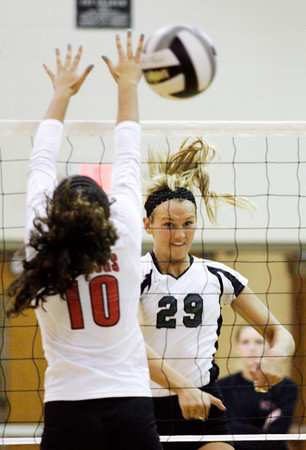 Floyd Central's Jordan Alvey attempts to hit the ball past New Albany's Audrey Donastrong during the second game of their match at Floyd Central on Thursday. Staff photo by Christopher Fryer