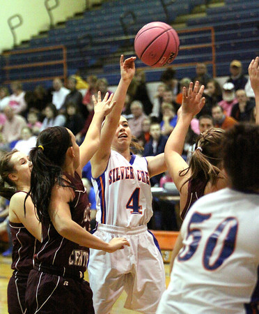Silver Creek guard Brooke Barnett throws a inlet pass against South Central Wednesday night. Staff photo by C.E. Branham