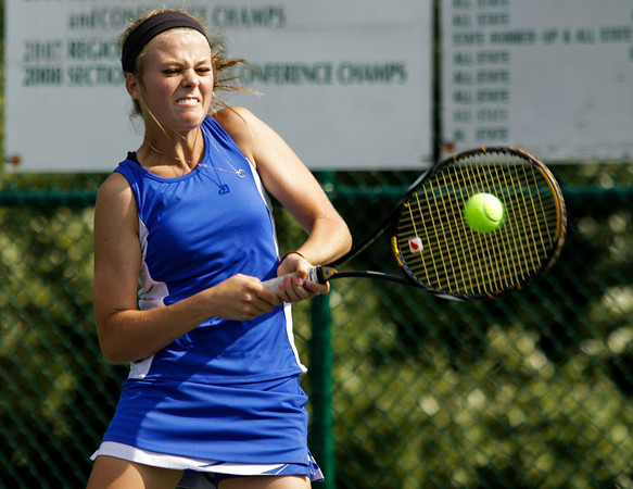 Silver Creek High School sophomore Kathleen Hebble returns the ball to New Albany High School senior Madeline Bellew during their No. 1 singles match at the Indiana High School Athletic Association Girl's Tennis Regional tournament at Floyd Central High School on Tuesday evening. Hebble won the match in two sets. 6-1, 6-1. Staff photo by Christopher Fryer