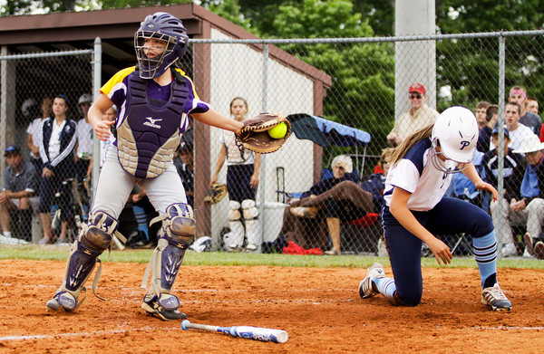 Eastern catcher Morgan Martin fails to tag out Providence freshman Marlee Karem at home plate during their game in the championship round of the Eastern sectional tournament on Thursday. Providence won the game in five innings, 19-2. Staff photo by Christopher Fryer