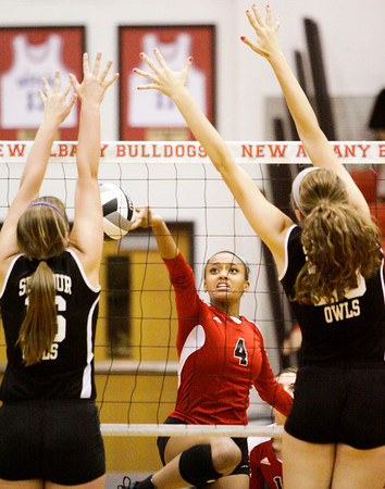 New Albany senior Kelsey Guess attempts to clear the net during their home match against Seymour on Thursday. Seymour took the match in three sets, 25-23, 25-23, 25-14. Staff photo by Christopher Fryer