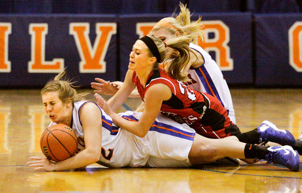 Borden's Shelby Kirchgessner challenges Silver Creek's Alex Tinsley, left, and Emily Clayton for possession of a loose ball during their game at Silver Creek on Thursday. Staff photo by Christopher Fryer